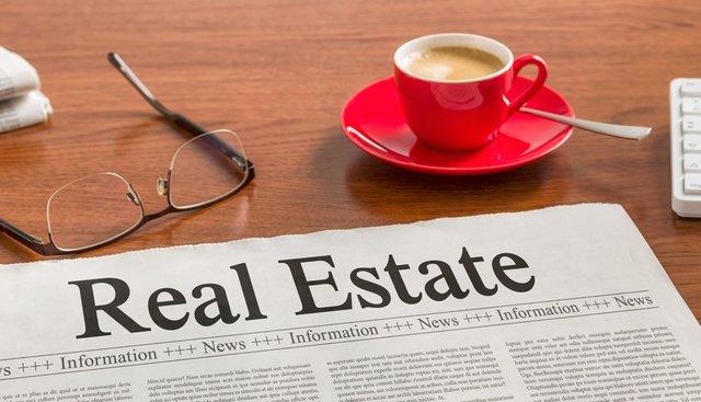 Newspaper on a wooden desk - Real Estate